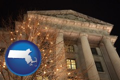 massachusetts map icon and the Internal Revenue Service building in Washington, DC
