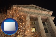wy map icon and the Internal Revenue Service building in Washington, DC
